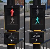 Pedestrian traffic lights. Red and green walk sign (road background Royalty Free Stock Image