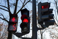 Pedestrian traffic lights, Bikes and Automotive Stock Images