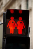Pedestrian traffic lights in Vienna. The city of Vienna has various pedestrian traffic lights showing a man and a woman, two man and two woman. This was intended Stock Photo