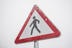 Pedestrian traffic signal covered on snow Stock Images