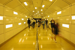 Pedestrian Tunnel. Pedestrian moving in a tunnel at blurred action Stock Photo