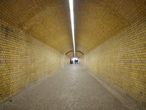 Pedestrian tunnel with long ceiling lamp Royalty Free Stock Photography