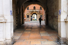 Pedestrian under the arch at Piazza della Signoria in Verona Royalty Free Stock Image