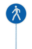 Pedestrian walking lane walkway footpath road sign on pole post, large blue round isolated route traffic roadside signage. Pedestrian walking lane walkway Stock Photography