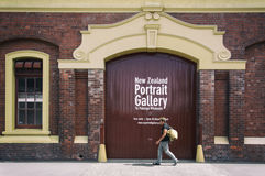 Pedestrian walking pass classic old building lo in Wellington CBD Stock Photos