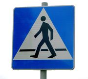 Pedestrian walking sign. Blue pedestrian crossing street sign in Poland Stock Photography