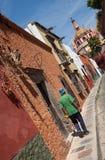 Pedestrian Walking Toward Cathedral in San Miguel de Allende of Mexico Royalty Free Stock Image