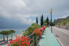 Pedestrian walkway along gardesana road and beach limone sul gar Royalty Free Stock Image