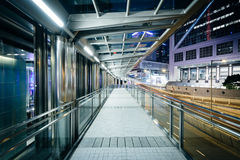 Pedestrian walkway and modern skyscrapers at night, in Hong Kong Royalty Free Stock Photography