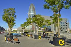 Pedestrian walkway with trees and modern architecture in Barcelona Spain royalty free stock image