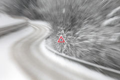Pedestrian warning sign on a snowy road Stock Photo