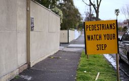 Pedestrian watch your step sign stock photo