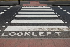 Pedestrian zebra crossing marked look left Stock Images