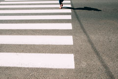 Pedestrian zebra with walking legs and asphalt Stock Photo
