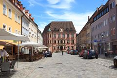 Pedestrian zone with shops and people in old town Kaufbeuren. Kaufbeuren, Germany - July 29, 2017: Pedestrian zone with shops and people in old town Kaufbeuren royalty free stock image