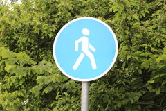 Pedestrian zone sign. Pedestrian zone sign against the background of green leaves of trees Stock Photography
