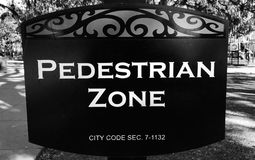 PEDESTRIAN ZONE - A SIGN IN SAVANNAH, GEORGIA WARNS PEOPLE AN AREA OF A PARK IS ONLY FOR WALKIN. Many people love to cycle these days, but also forget that other Royalty Free Stock Images