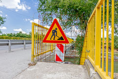 Pedestrian zone, street is closed with triangle sign for road works. Closed enter at construction zone, work in progress, sign with boundary are symbols of stock image