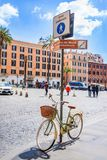 Pedestrian zone street sign with a retro styled female bicycle parked under. Walking aria in Rome city center. Stock Images
