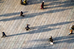 Pedestrianised zone. People walking in a pedestrianised zone at the sunset Royalty Free Stock Photography