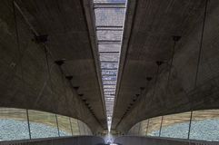 Pedestrianized road is beneath motorway, coupled concrete and steel. Royalty Free Stock Image