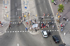 Pedestrians. Crossing a busy road Royalty Free Stock Image