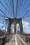 Pedestrians and bicyclists crossing Brooklyn Bridge Stock Photography