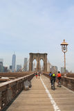 Pedestrians and bicyclists crossing Brooklyn Bridge Royalty Free Stock Images
