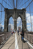 Pedestrians and bicyclists crossing Brooklyn Bridge Royalty Free Stock Photos