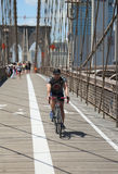 Pedestrians and bicyclists crossing Brooklyn Bridge Stock Images