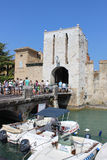 Pedestrians on brigde entering Sirmione, Italy Royalty Free Stock Image