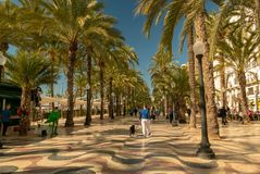 Pedestrians in the busy esplanade of Spain, in Alicante royalty free stock photo