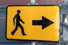 Pedestrians bypass direction. Yellow road sign Stock Images