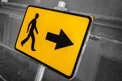 Pedestrians bypass direction. Yellow road sign Stock Photo