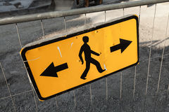 Pedestrians bypass directions. Yellow road sign Royalty Free Stock Photography