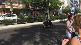 Pedestrians can not cross road through crosswalk due traffic. Nha Trang, Vietnam - 10 March, 2017. Pedestrians can not cross road through crosswalk due traffic stock video footage