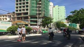 Pedestrians can not cross road through crosswalk due traffic. Nha Trang, Vietnam - 10 March, 2017. Pedestrians can not cross road through crosswalk due traffic stock video
