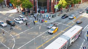 Pedestrians and cars on the crossroad in San Francisco.  stock video footage