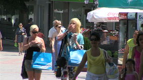 Pedestrians in the central square of Varna, Bulgaria stock video footage