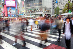 Pedestrians cross at Shibuya Crossing Stock Image