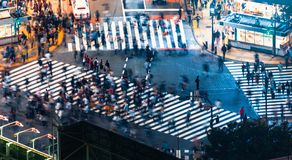 Pedestrians cross the Shibuya Scramble crosswalk, in Tokyo, Japan. Pedestrians cross the Shibuya Scramble crosswalk in Tokyo, Japan, one of the busiest Royalty Free Stock Photography