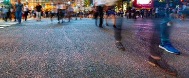 Pedestrians cross the Shibuya Scramble crosswalk, in Tokyo, Japan. Pedestrians cross the Shibuya Scramble crosswalk in Tokyo, Japan, one of the busiest Royalty Free Stock Images