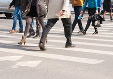 Pedestrians cross the street Stock Photography