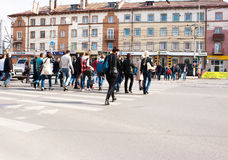 Pedestrians cross the street at the crosswalk Royalty Free Stock Images
