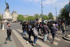 Pedestrians cross the street in Paris, France royalty free stock photo