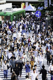 Pedestrians crossing the busiest crosswalk in the world in the Shibuya district in Tokyo, Japan Stock Photo