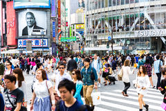 Pedestrians crossing the busiest crosswalk in the world in the Shibuya district in Tokyo, Japan Royalty Free Stock Photos