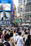 Pedestrians crossing the busiest crosswalk in the world in the Shibuya district in Tokyo, Japan Royalty Free Stock Images