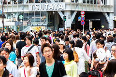 Pedestrians crossing the busiest crosswalk in the world in the Shibuya district in Tokyo, Japan Stock Image