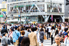 Pedestrians crossing the busiest crosswalk in the world in the Shibuya district in Tokyo, Japan Royalty Free Stock Photography